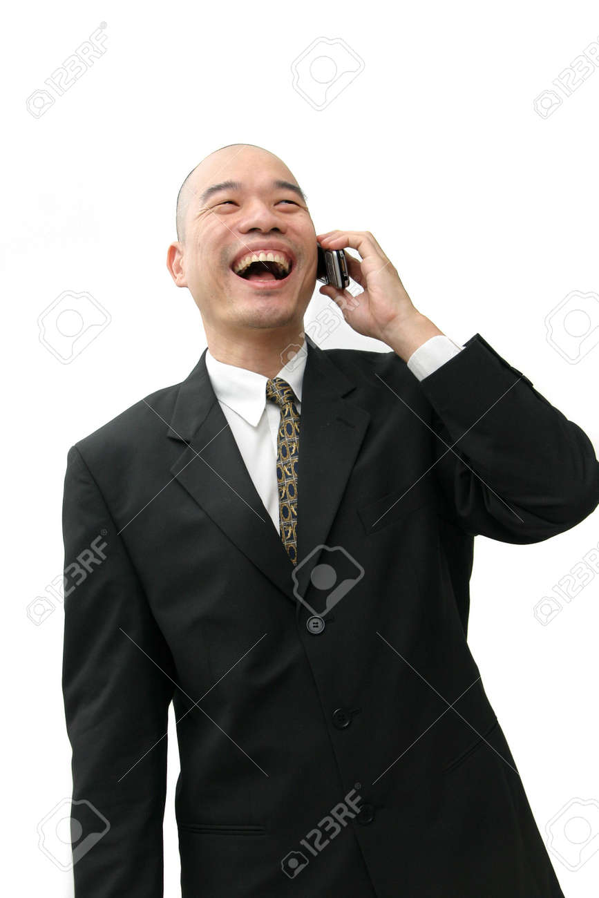 Oriental man in suit on cell phone looking happy and laughing. Stock Photo - 337036