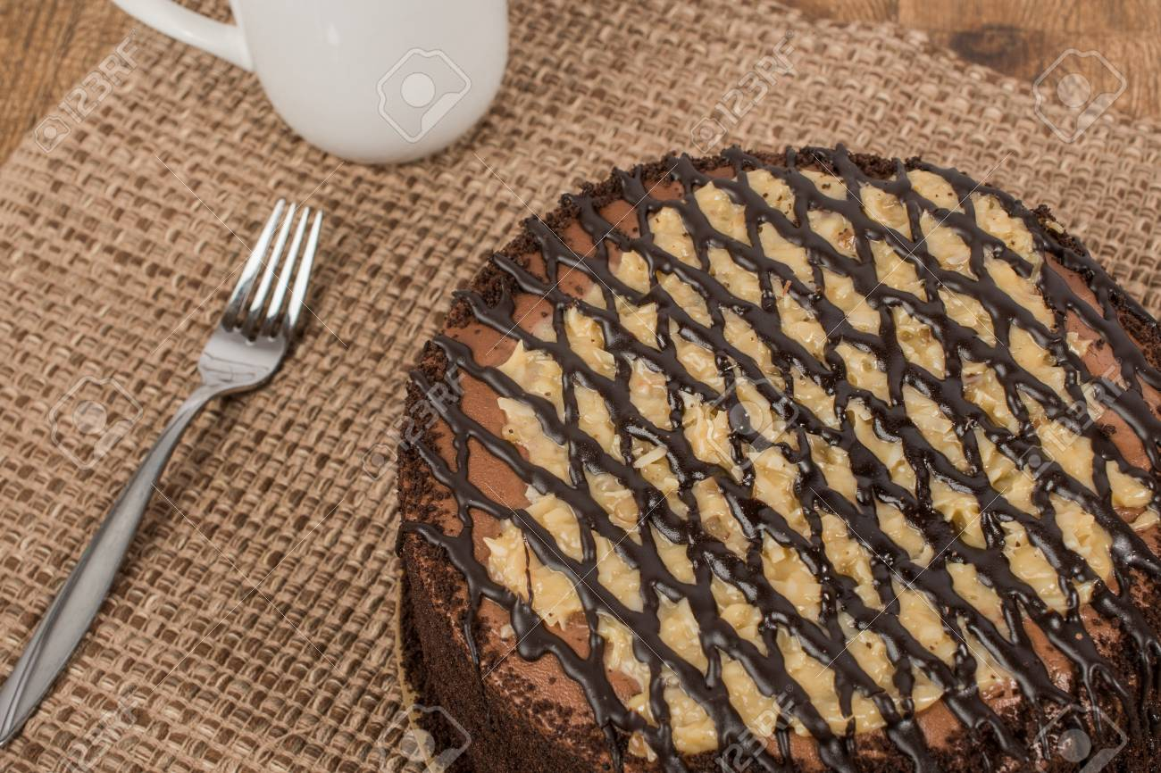 German Chocolate Cake With Fork And Cup And Rustic Background Stock Photo Picture And Royalty Free Image Image 71229956