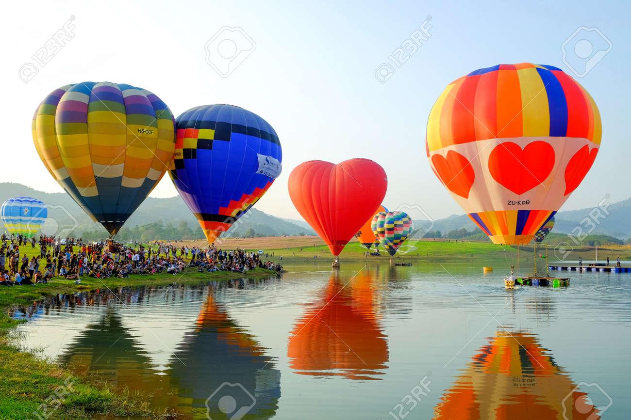Chiang Rai-Thailand FEB 16 2017: People and tourists are watching hot-air balloon show at the Singha Park Chiang Rai International Balloon Fiesta, locate on Singha Park, Chiang Rai, Thailand - 168055548