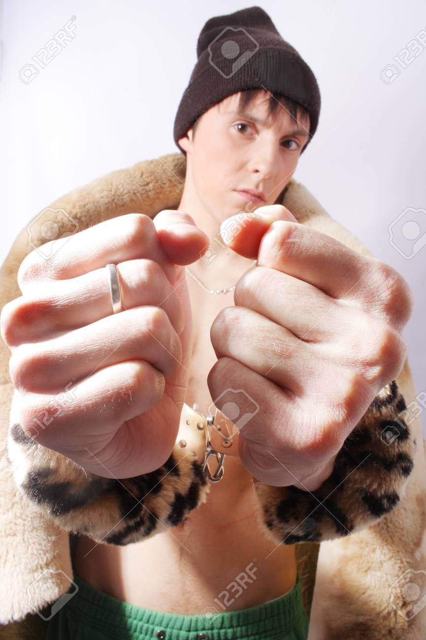 Man in handcuff and fur on white background Stock Photo - 7465864