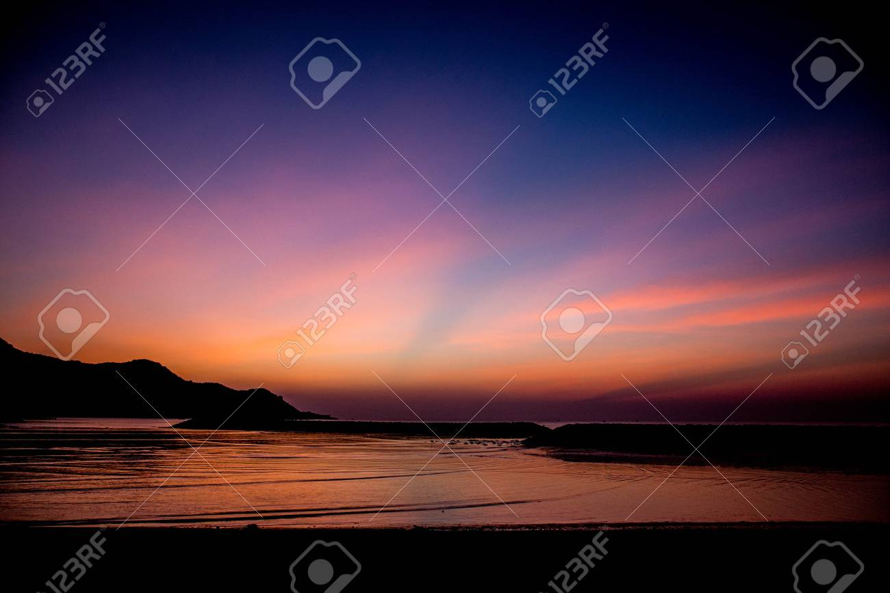 Beautiful sunrise at early morning on the beach. Stock Photo - 24611422
