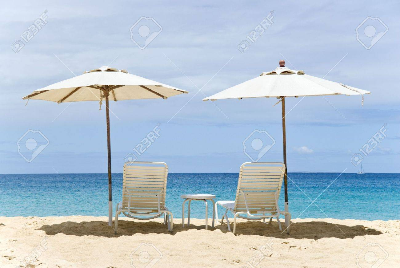 Beach chairs with umbrella - Beach Chairs And Umbrellas On The Beach Stock Photo 4794388
