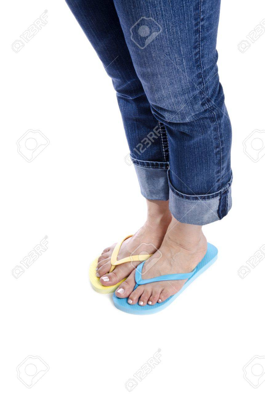 605b12b1b Woman Wearing Mismatched Flip Flops Isolated on White Stock Photo - 14285797