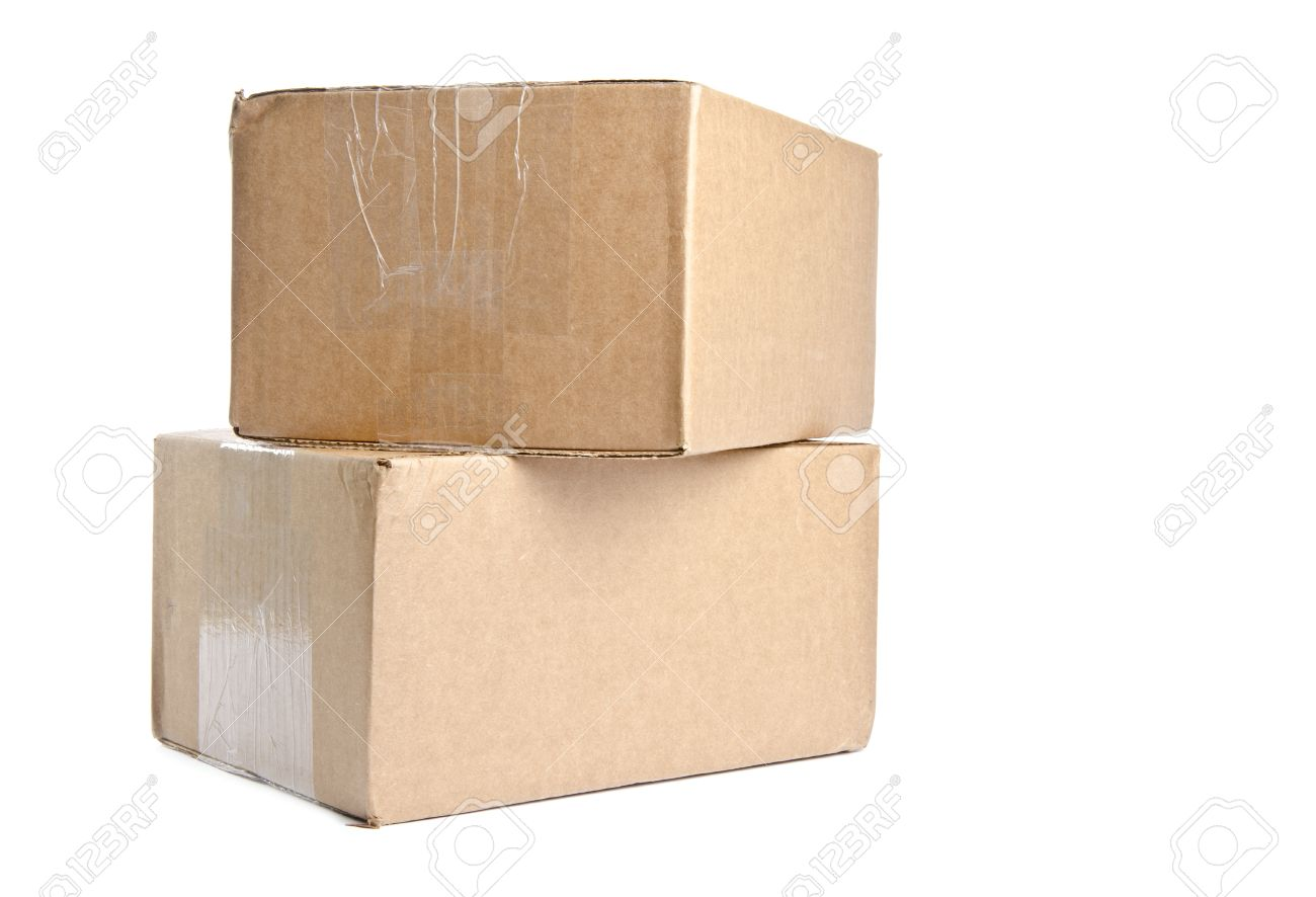 two cardboard boxes stacked and isolated on white stock photo
