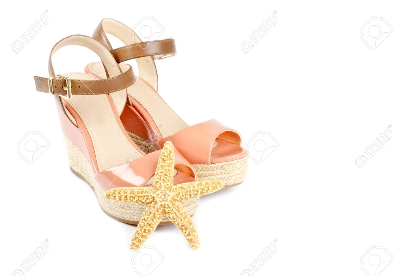 Peach Colored Wedge Sandals Isolated on White Stock Photo - 17973302