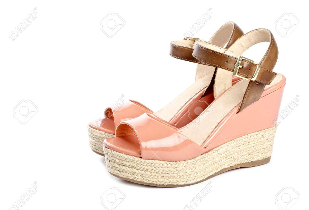 peach colored wedge sandals isolated on white stock photo picture
