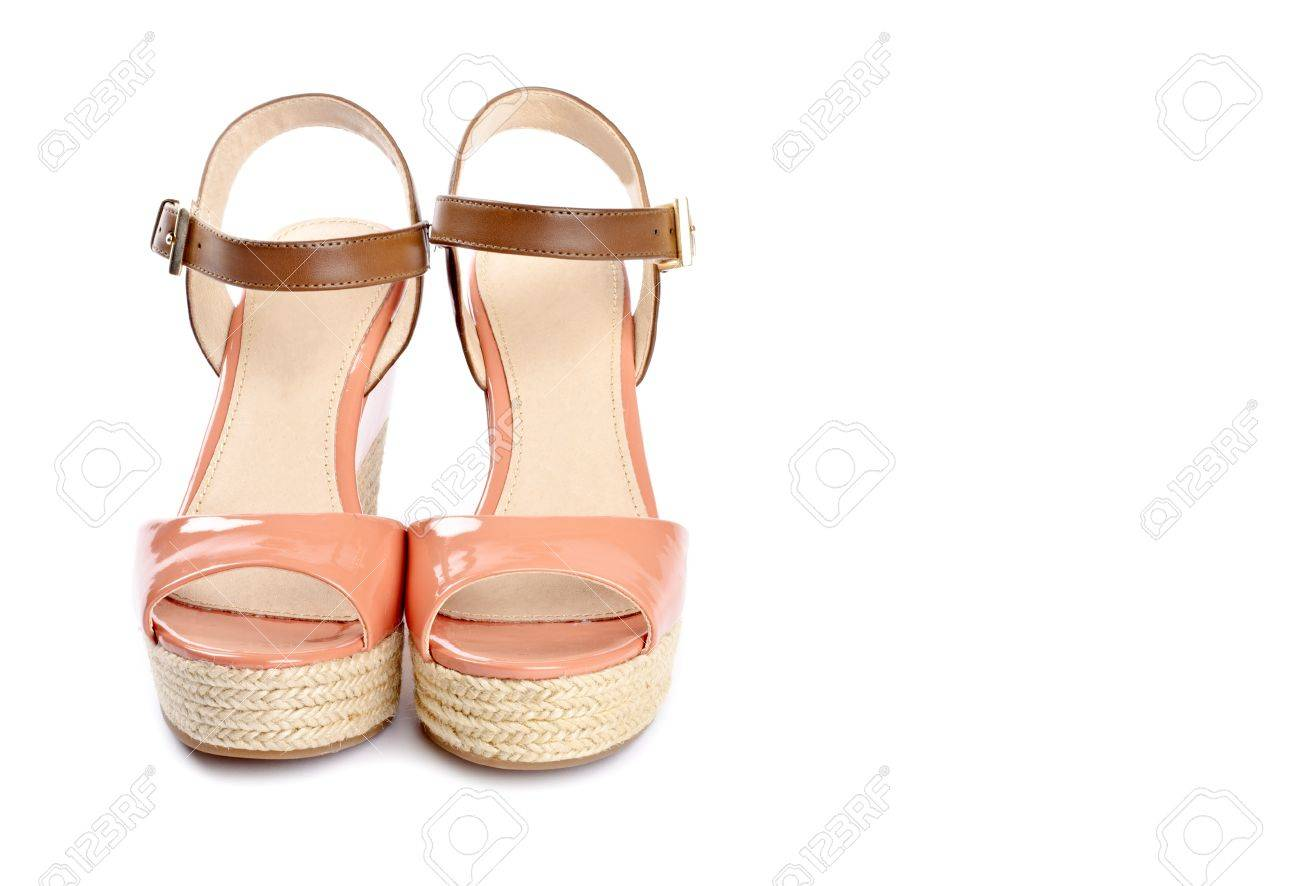 6379a257853 Peach Colored Wedge Sandals Isolated on White Stock Photo - 17973303