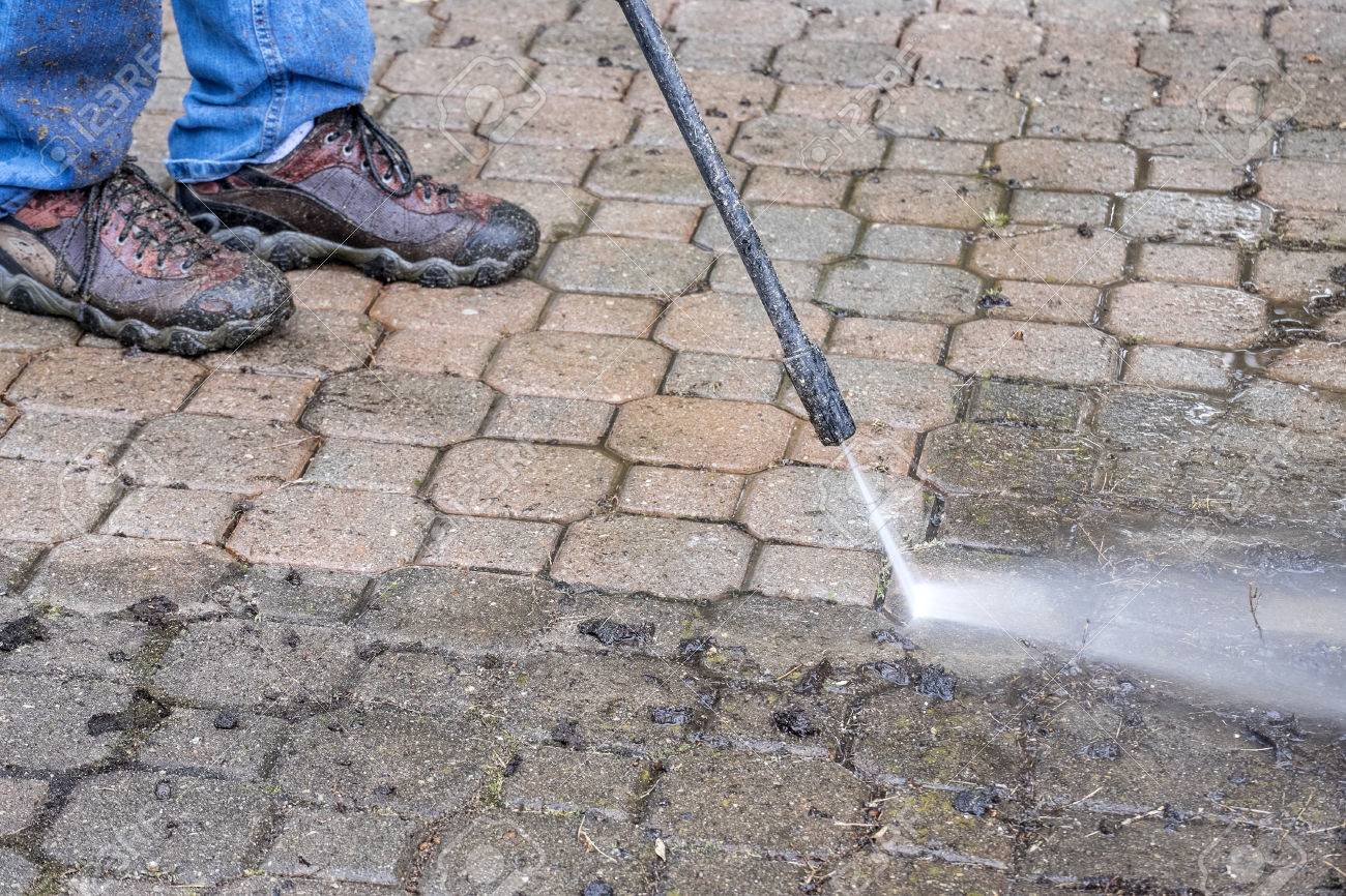 Man Cleaning Patio With A Power Washer Stock Photo   30507824