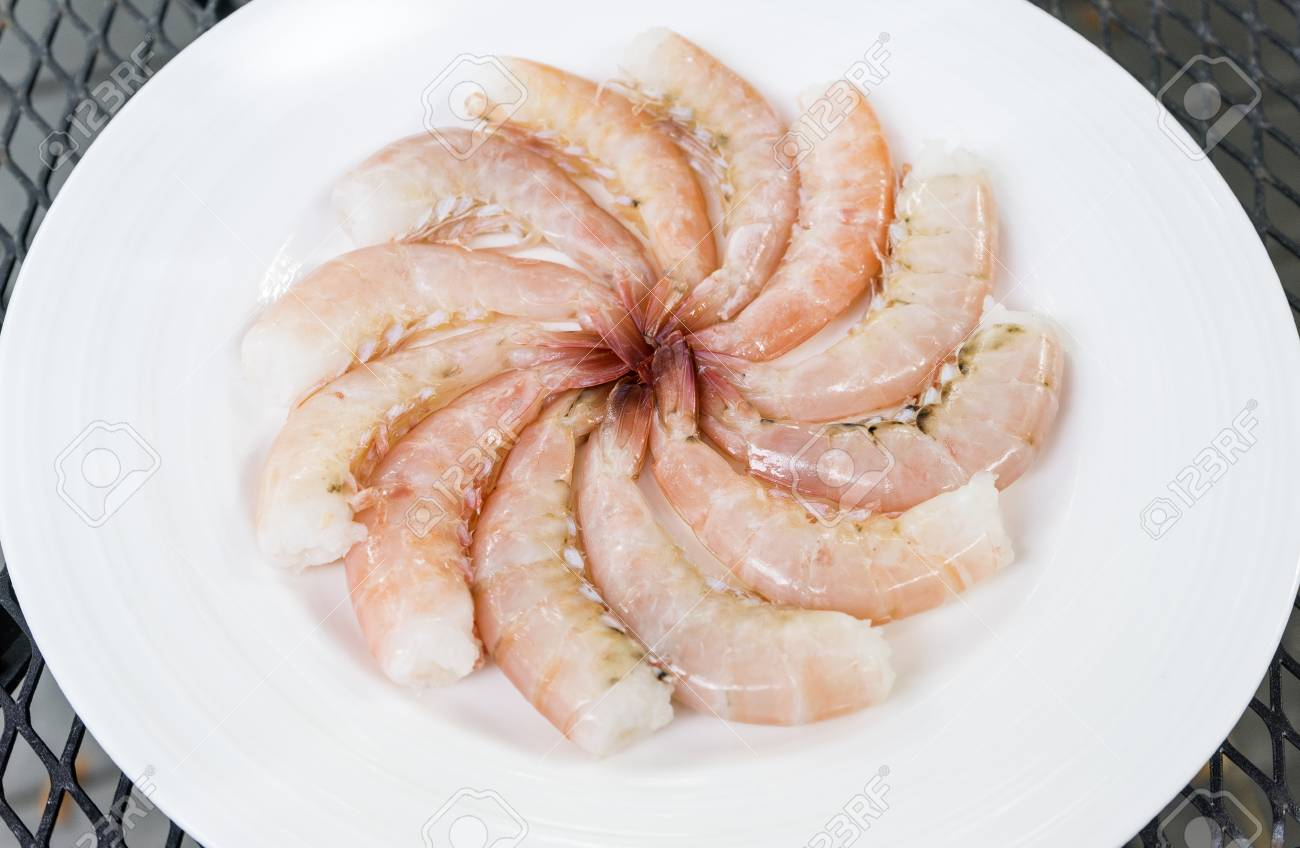 Raw Florida Pink Shrimps On A White Plate Stock Photo Picture And