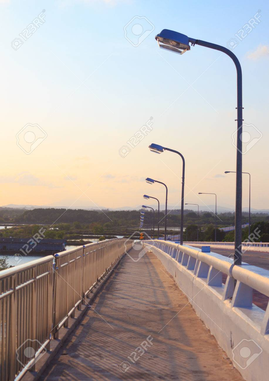 Roadway light poles stock photos pictures royalty free roadway street light pole sunset on highway evening rural countryside arubaitofo Choice Image