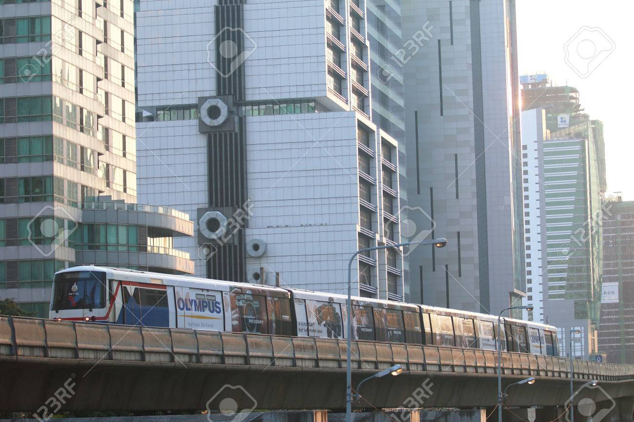 Bangkok, Thailand : March 12, 2016 : The Bangkok Mass Transit System BTS or Skytrain runs through the city center Chong Nonsi Station, Silom line(in bound) with Bangkok skyscraper in background - 55062195