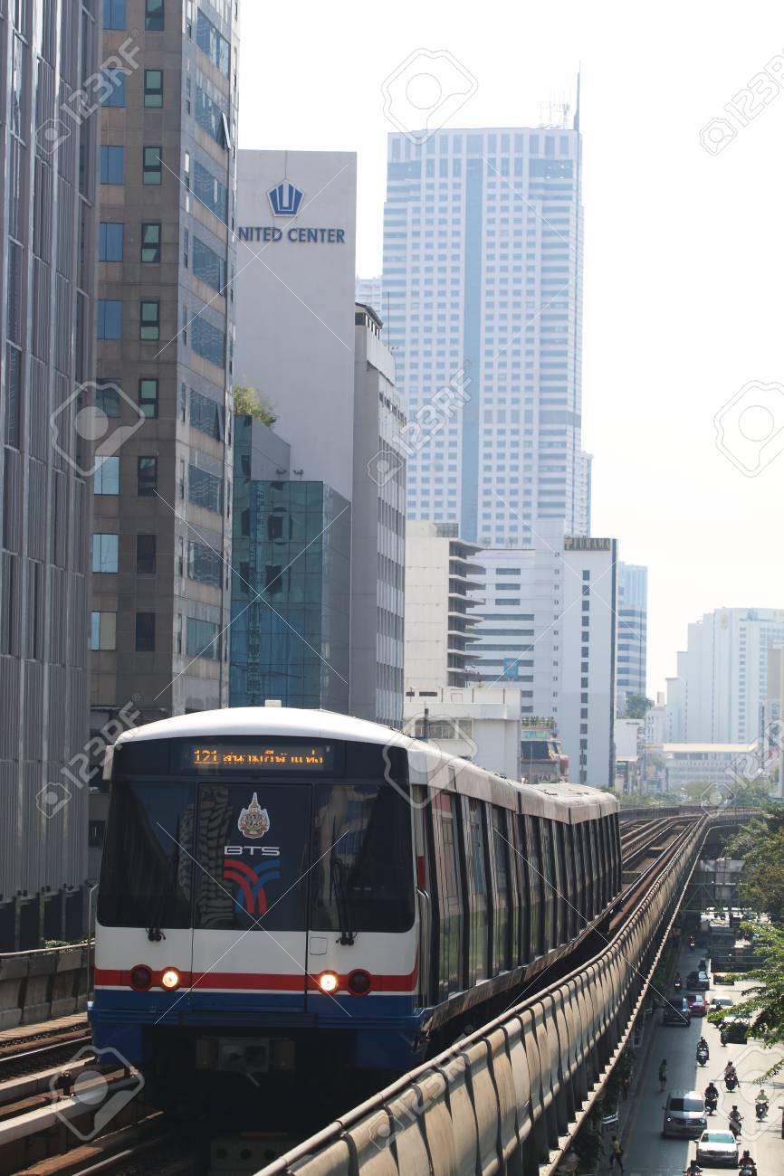 Bangkok, Thailand : March 14, 2016 : The Bangkok Mass Transit System BTS or Skytrain runs through the city center Saladaeng Station, Silom line(in bound) with Bangkok skyscraper in background - 55062194
