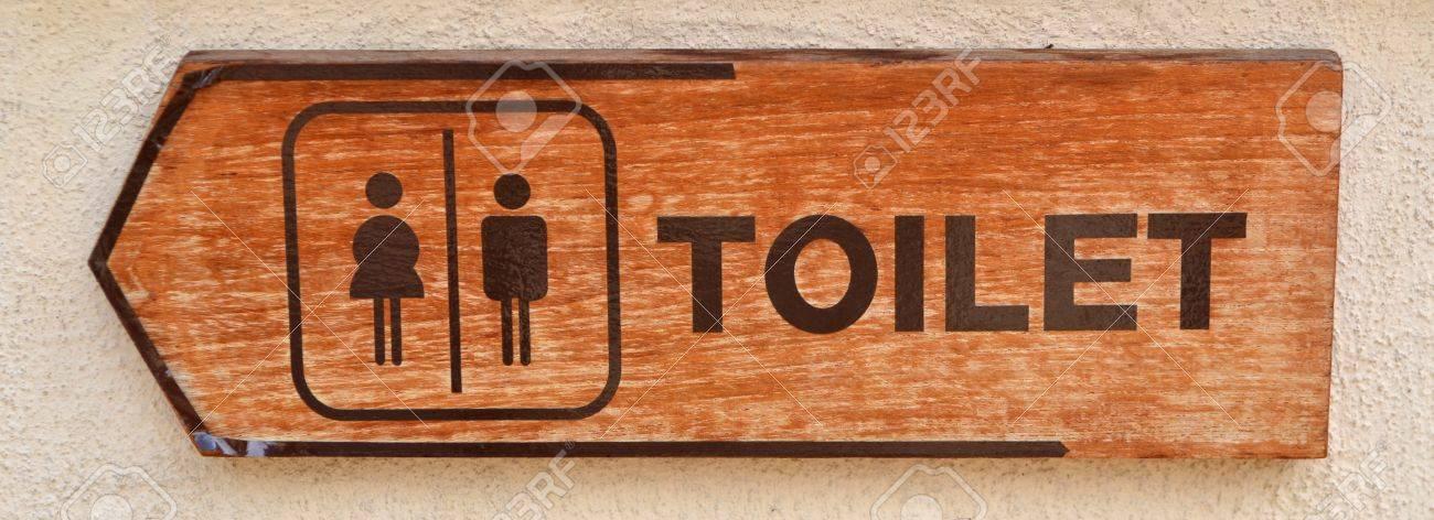 toilet plate sign on orange wall Stock Photo - 13505821