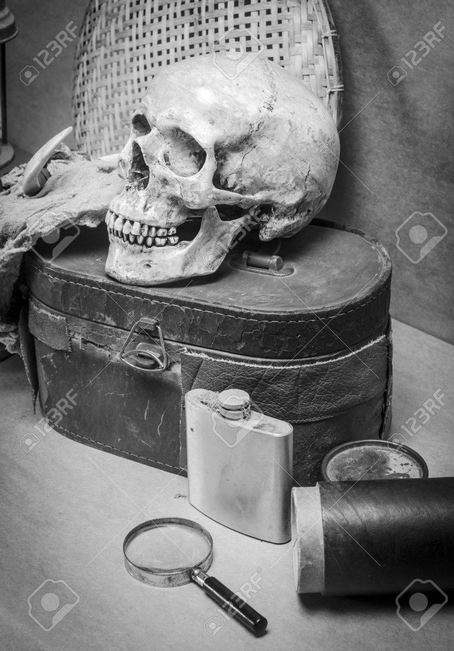 Still life with human skull with old items in black and white stock photo 26837558