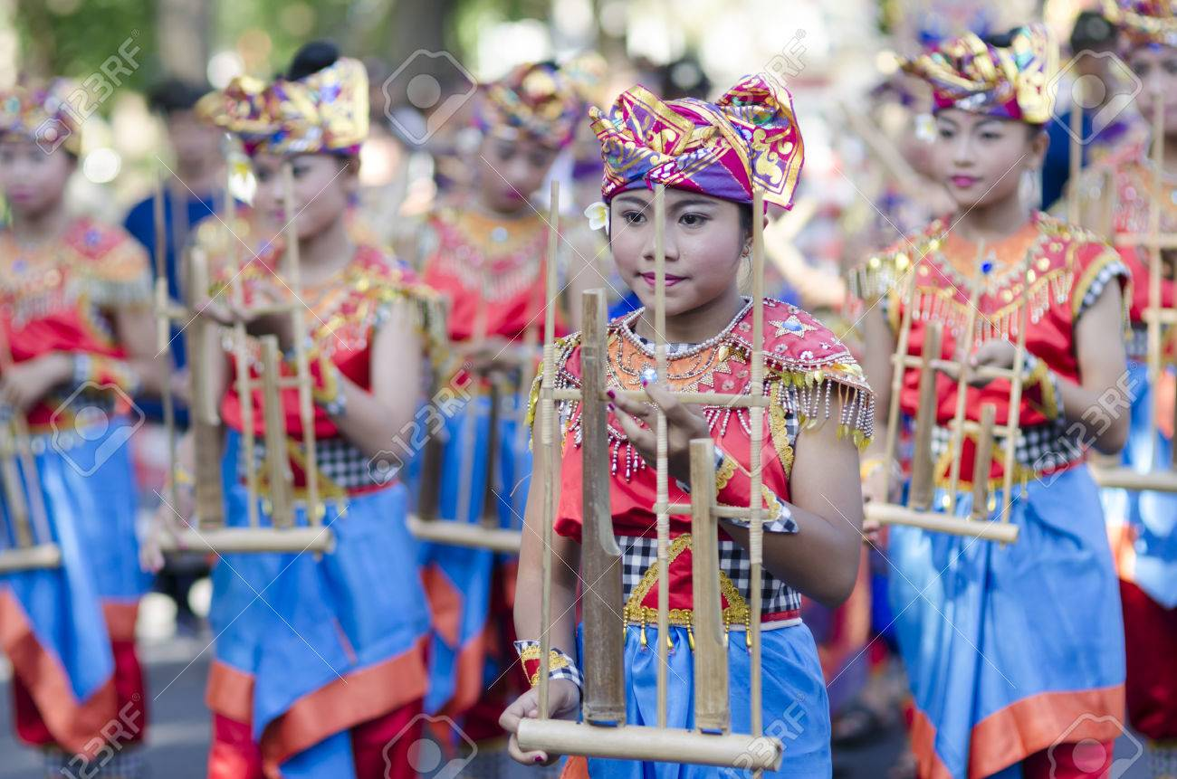 DENPASAR, BALI, INDONESIA - JUNE 18: Unidentified dancer of Balinese in colorful dresses variety on the parade at Bali Art Festival on June 18, 2014 in Denpasar, Indonesia - 29774559