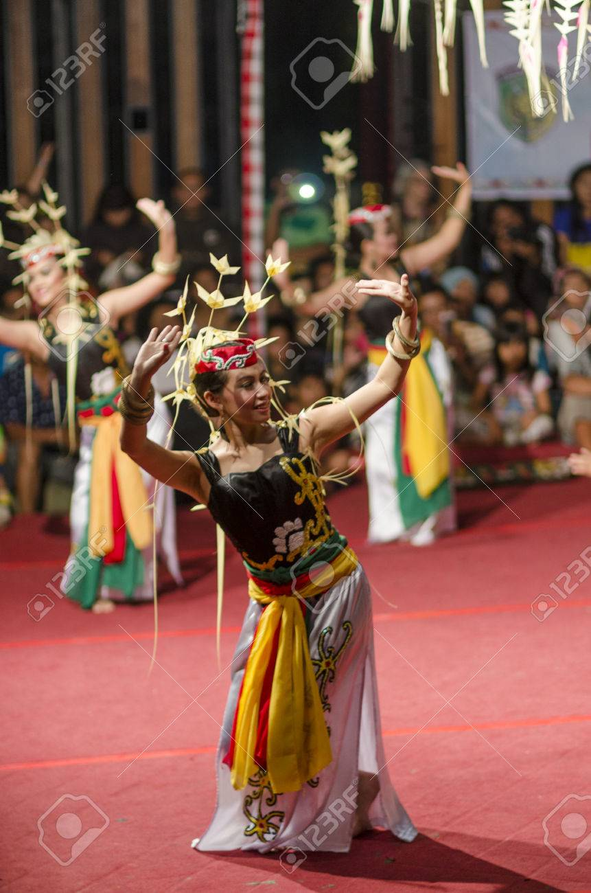 DENPASAR, BALI, INDONESIA - JUNE 14: Unidentified dancer from the indigenous Borneo people performs a traditional Borneo dance at Bali Art Festival on June 14, 2014 in Denpasar, Indonesia - 29774542