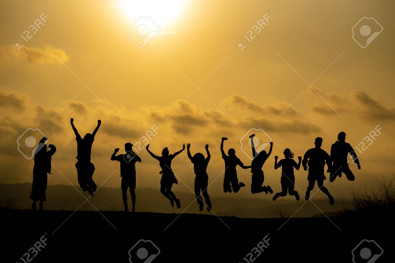 Silhouette of happy business human team making high hands over head in sunset sky evening time background for business teamwork concept and freedom - 120704197