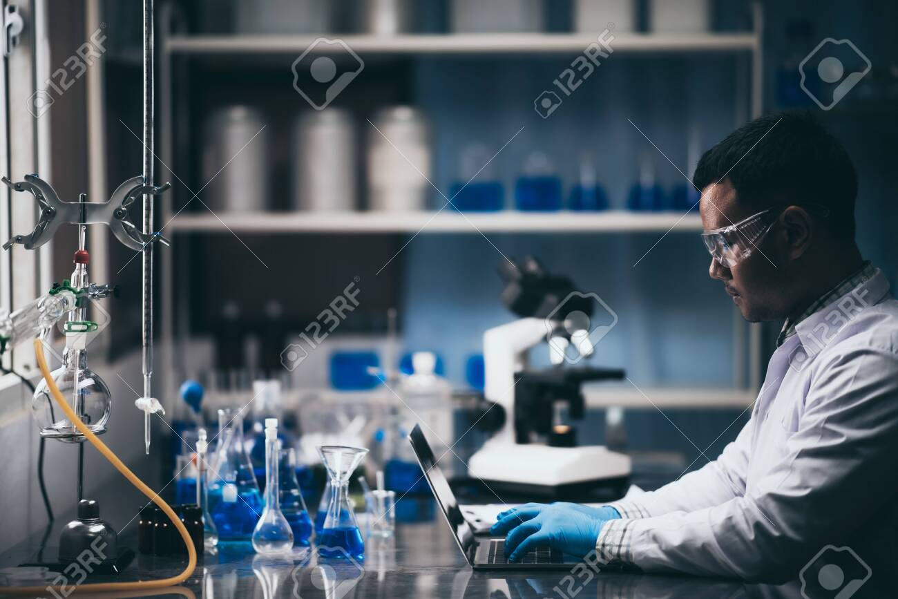 researchers are studying chemistry in the laboratory. - 141560665