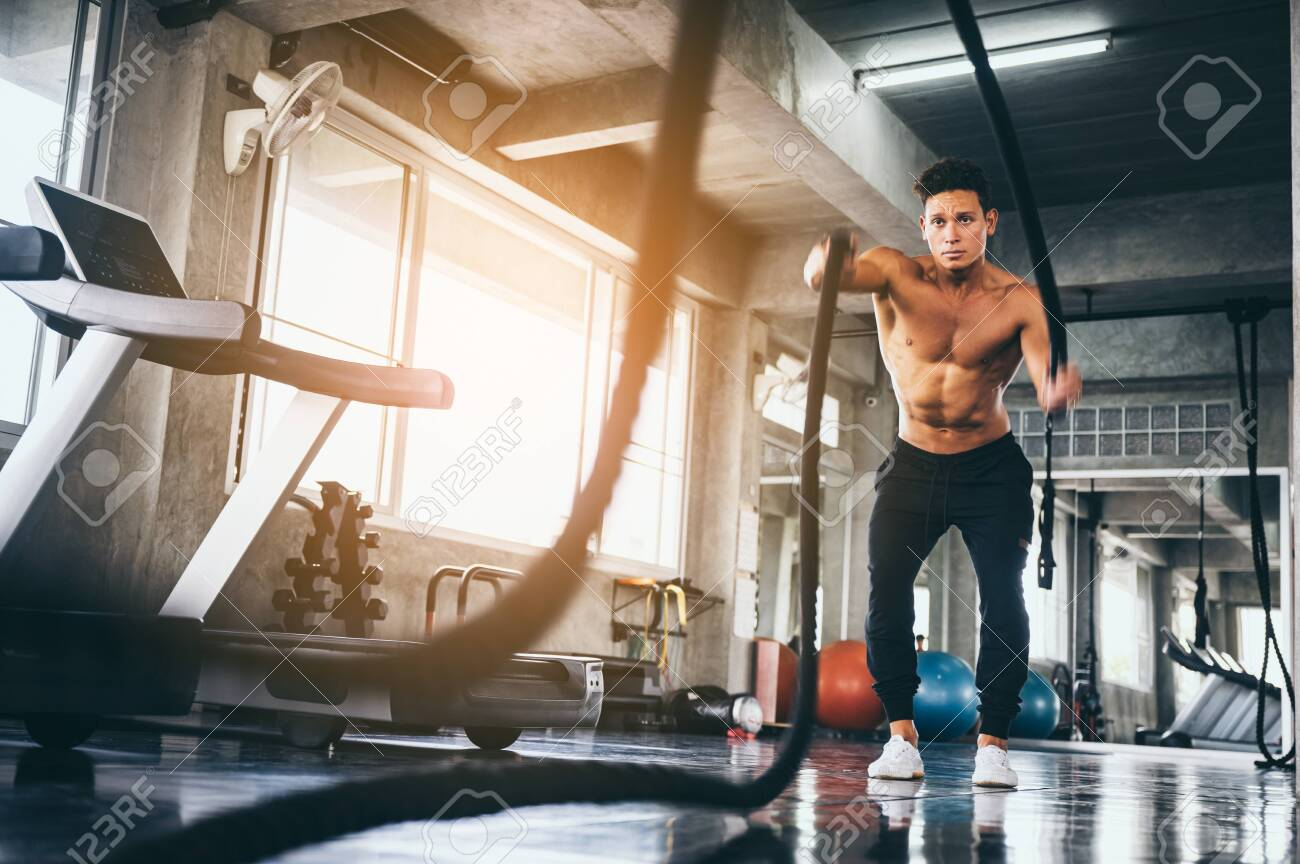 strong man exercising in the sport gym - 141560812