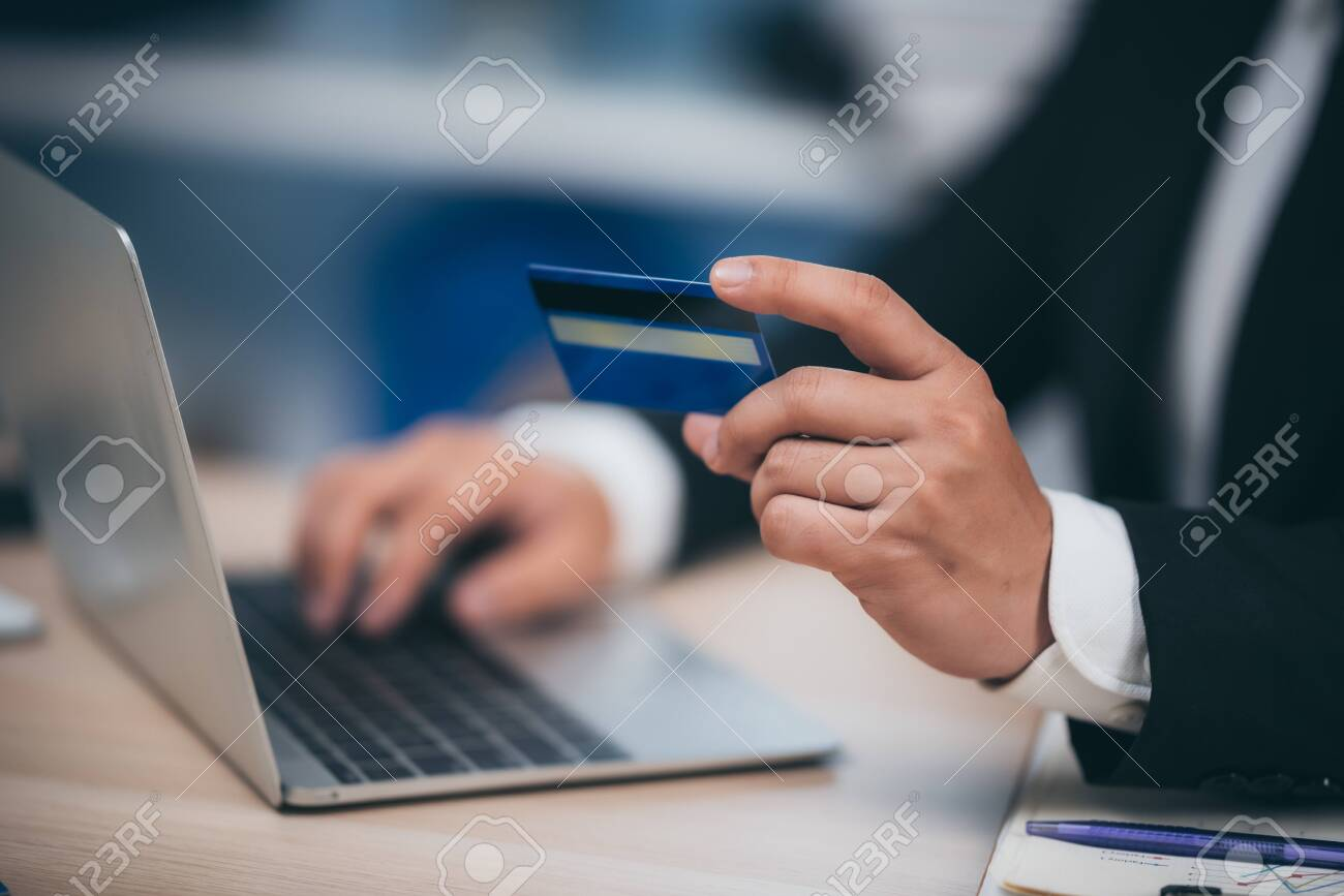 businessman working with credit card and laptop - 139437137