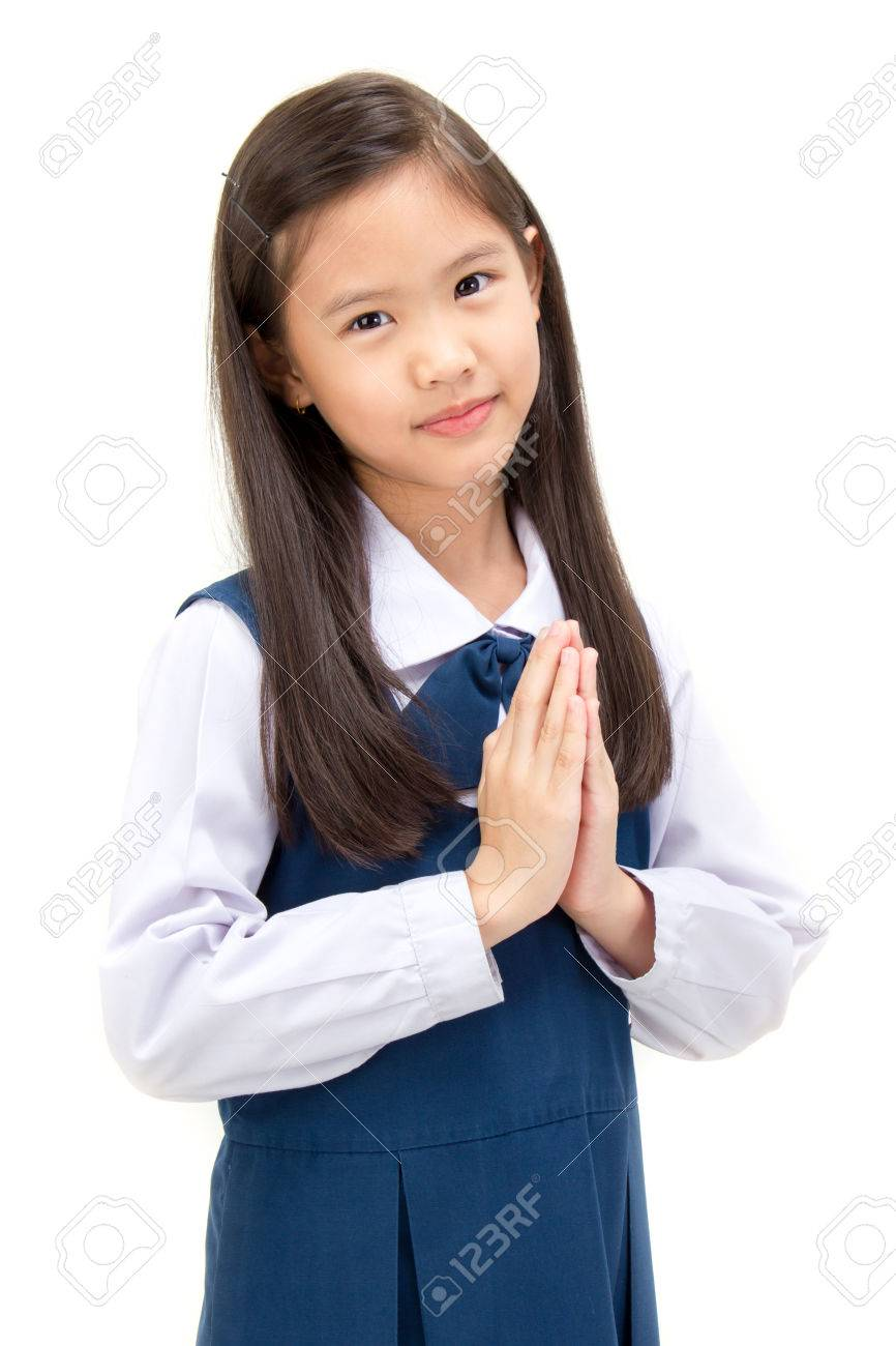 62560eee2 Portrait of asian child in school uniform with traditional greeting of  Thailand on white background isolated