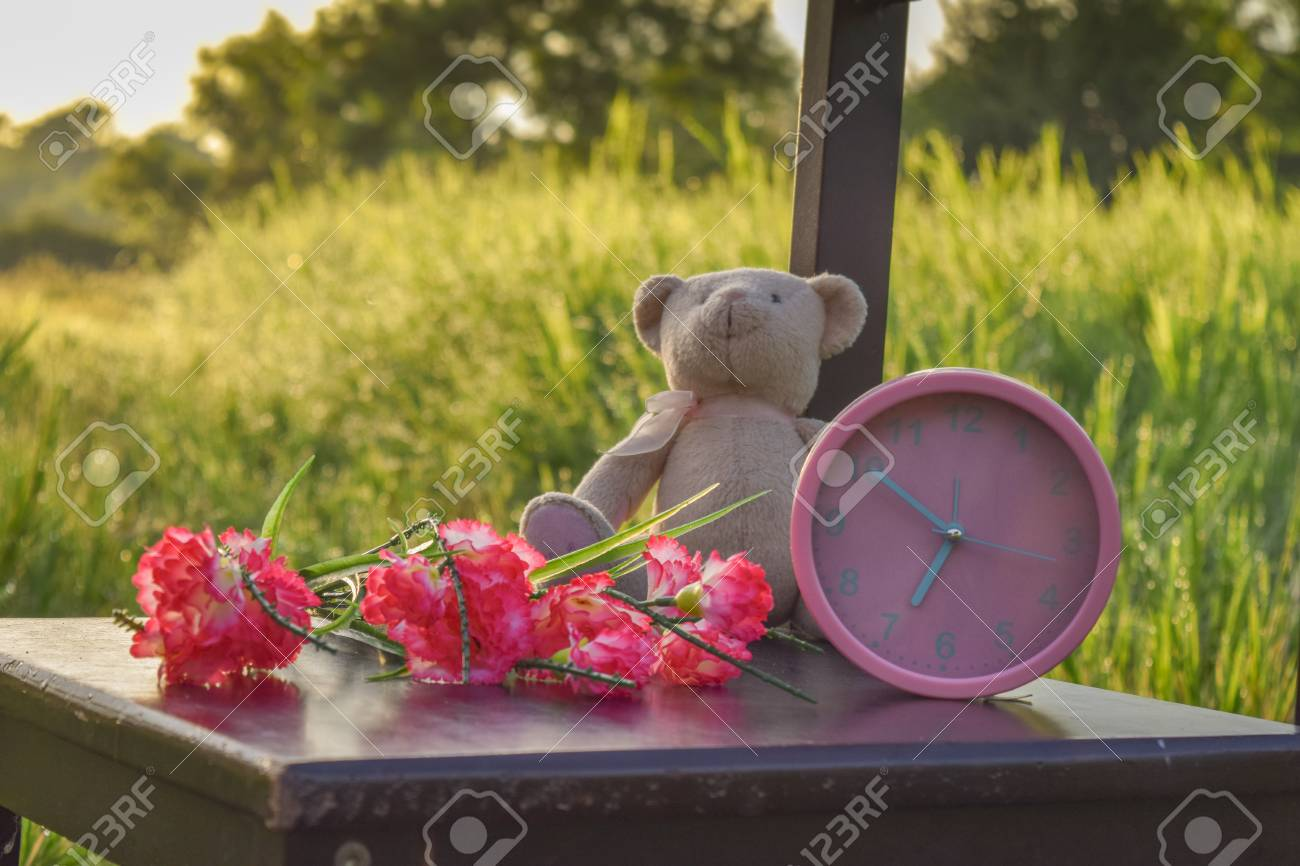 Alarm Clock Good Morning Teddy Bear And Flower Background Stock