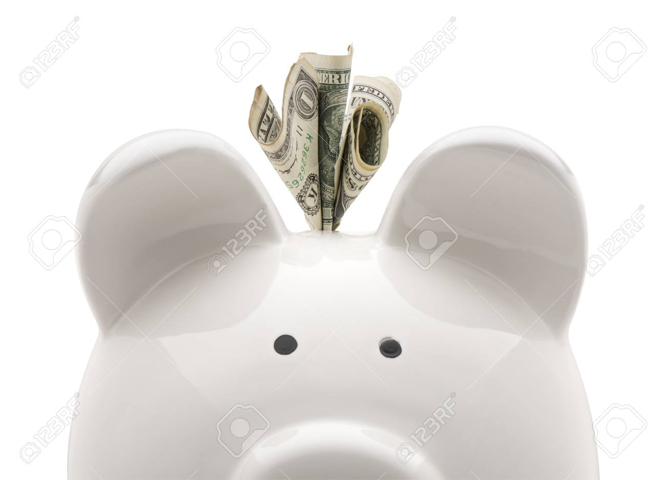 Close-up white piggy bank and US dollars. Isolated on white background - 69873872