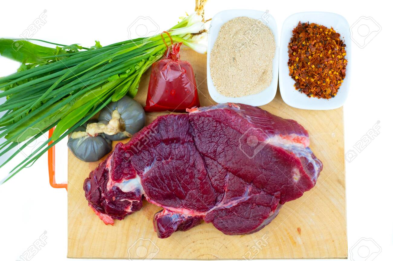 Raw beef and spices for Thai food cooking recipes is spicy minced