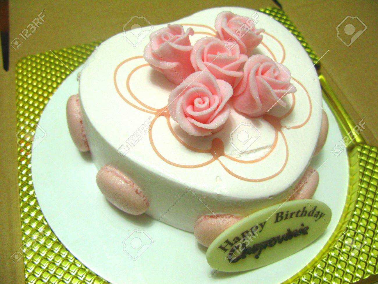 Heart Shaped Birthday Cake Topped With Rose Decoration Stock Photo