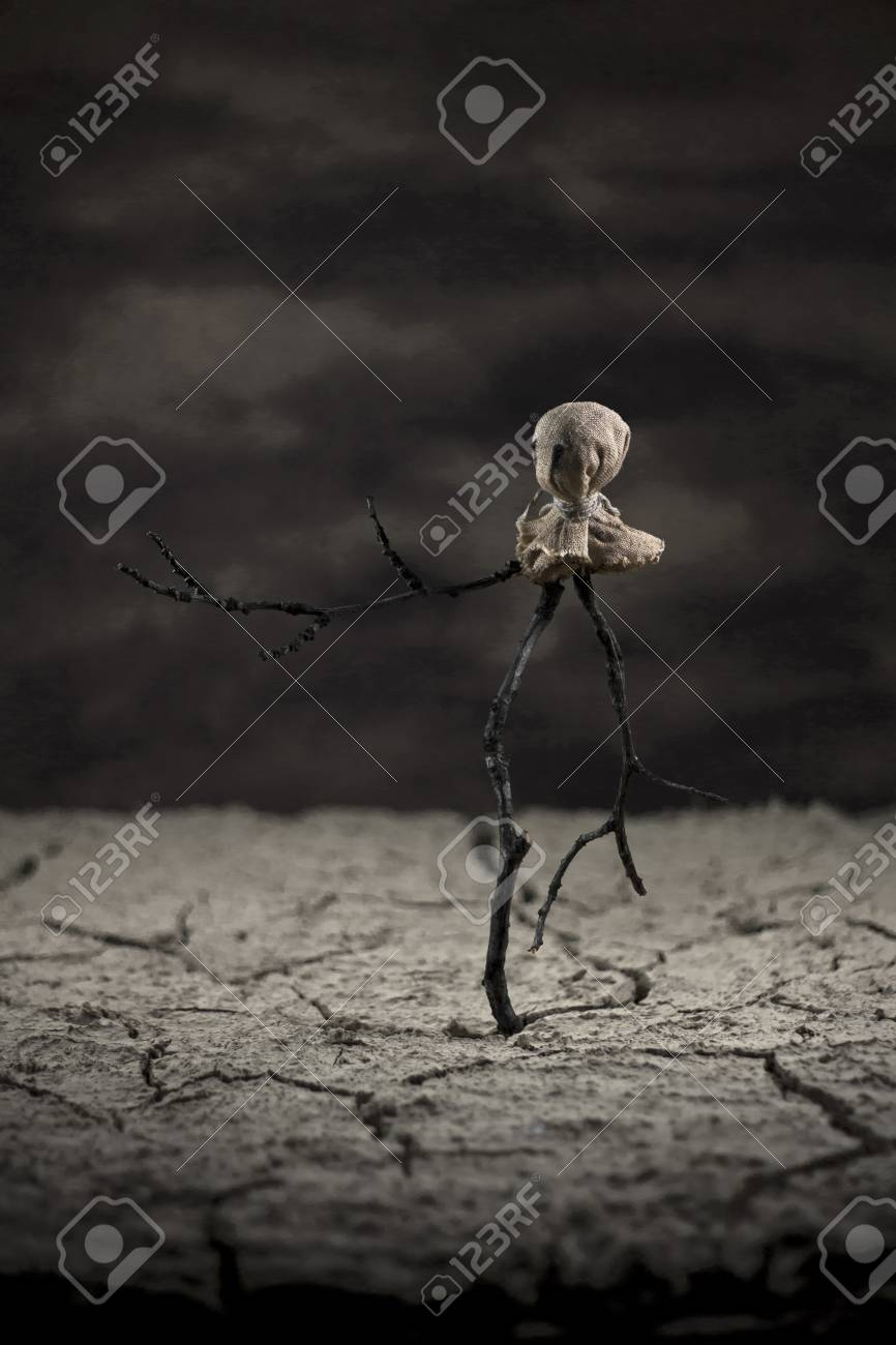 Scarecrow in the desert standing alone Stock Photo - 17485821