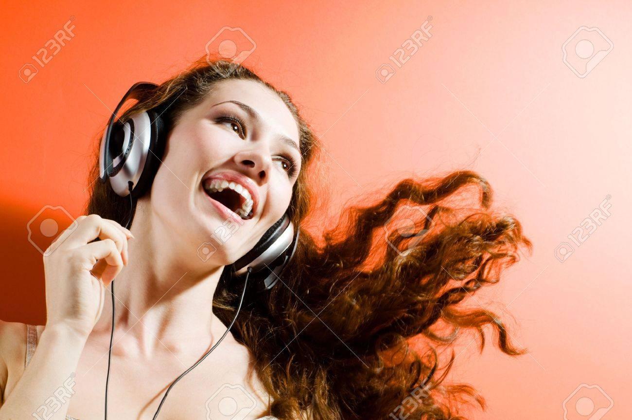 girl in headphones on the orange background Stock Photo - 3650378