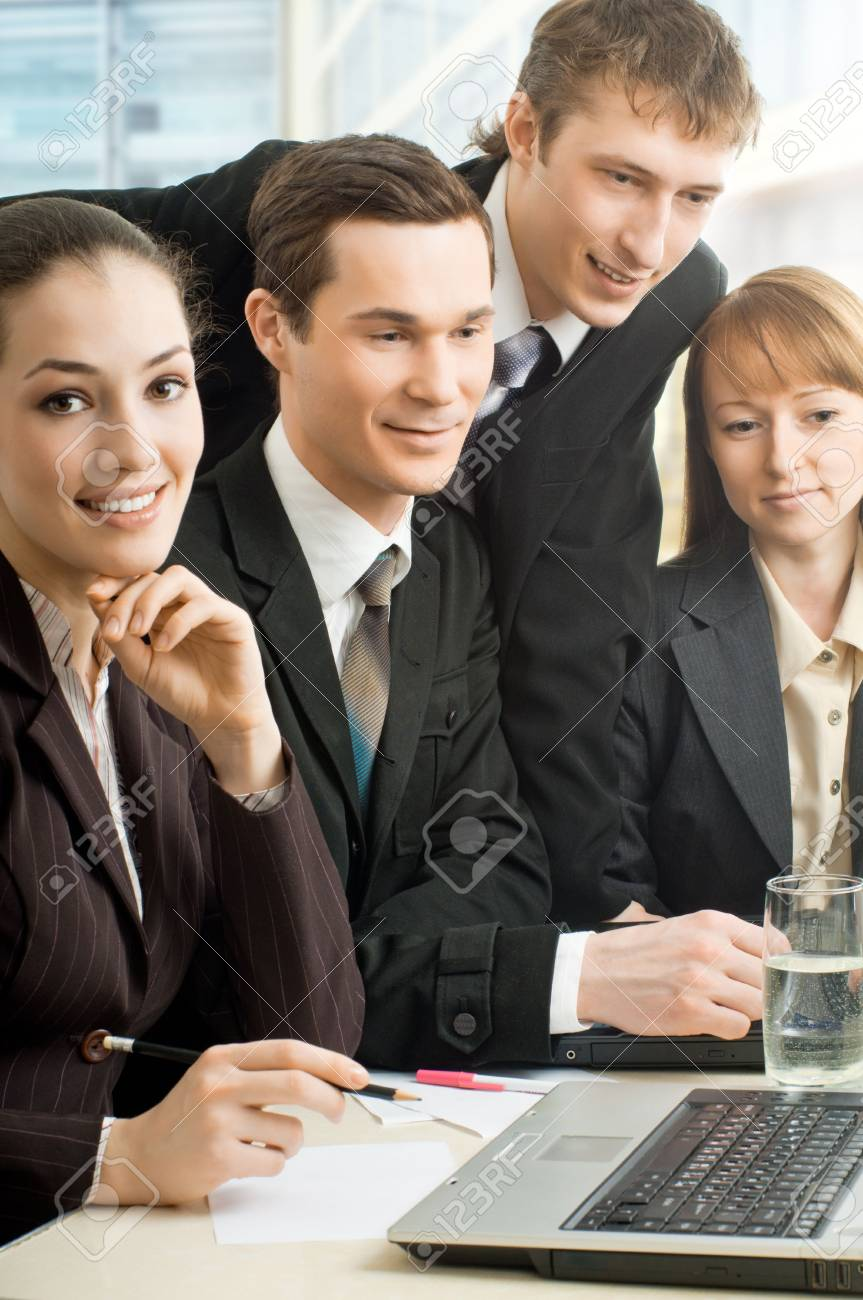 team of successful smiling young business people Stock Photo - 4477948