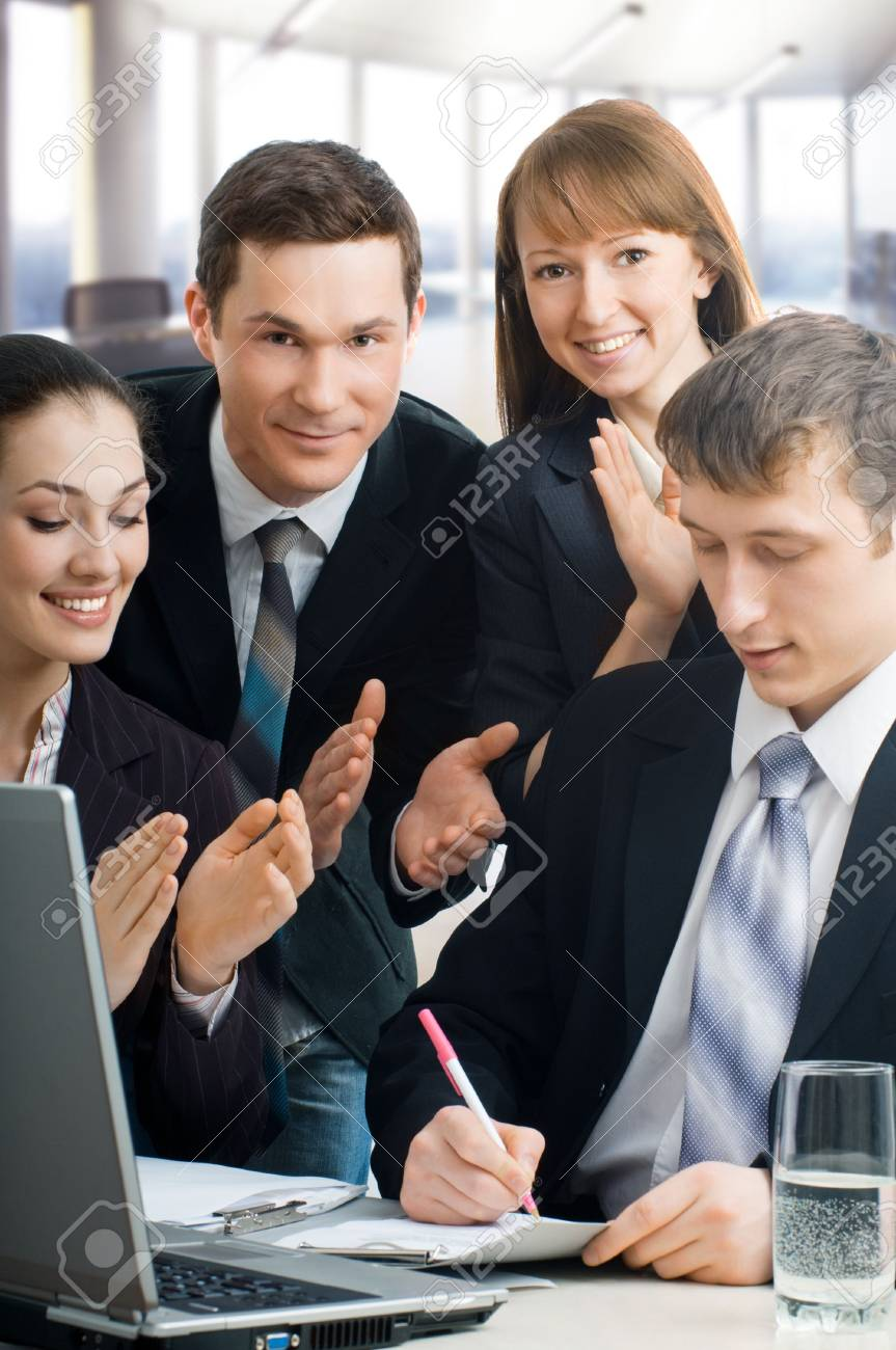 team of successful smiling young business people Stock Photo - 4736991