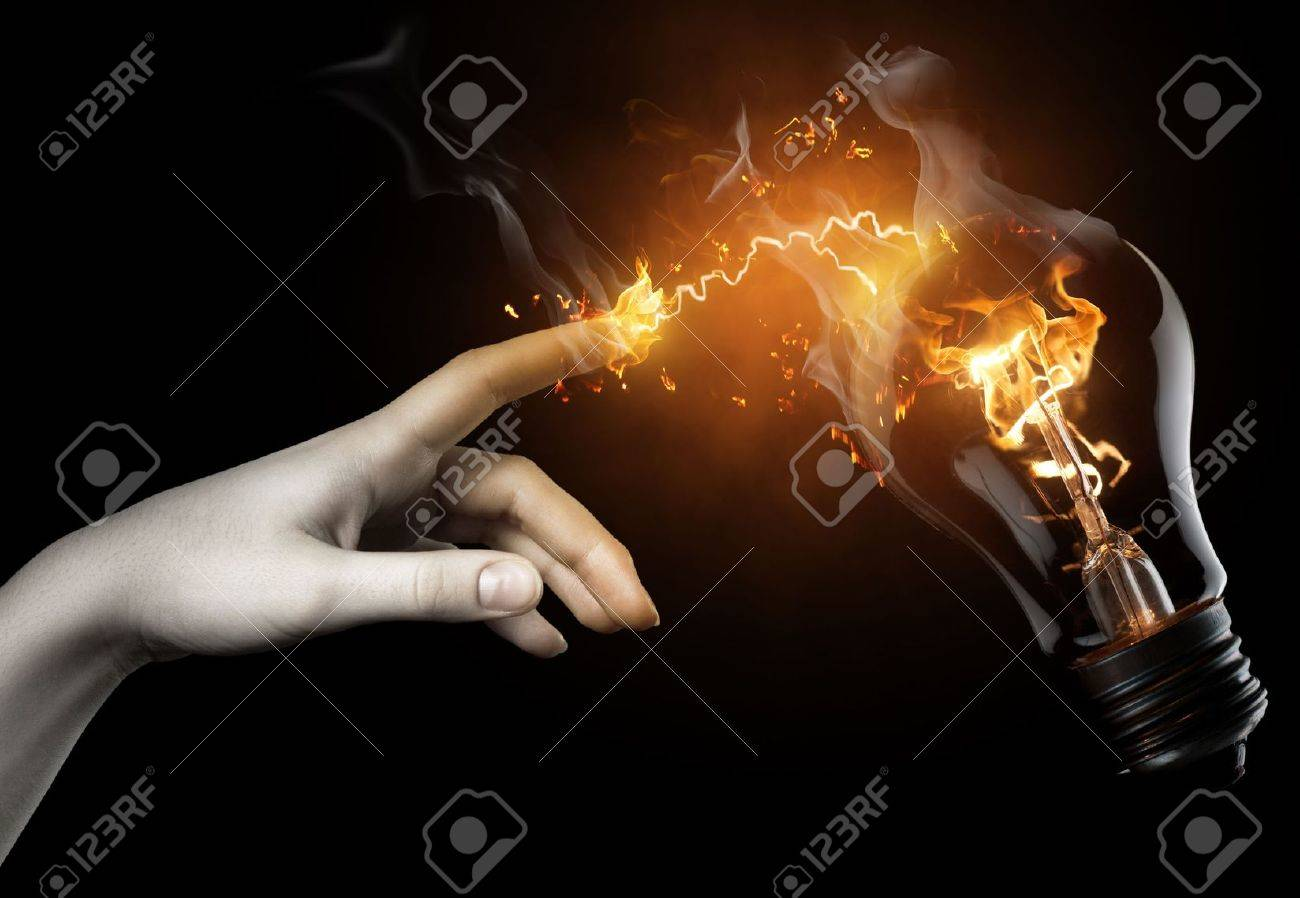 a woman pointing to the illuminated bulb - 6737066