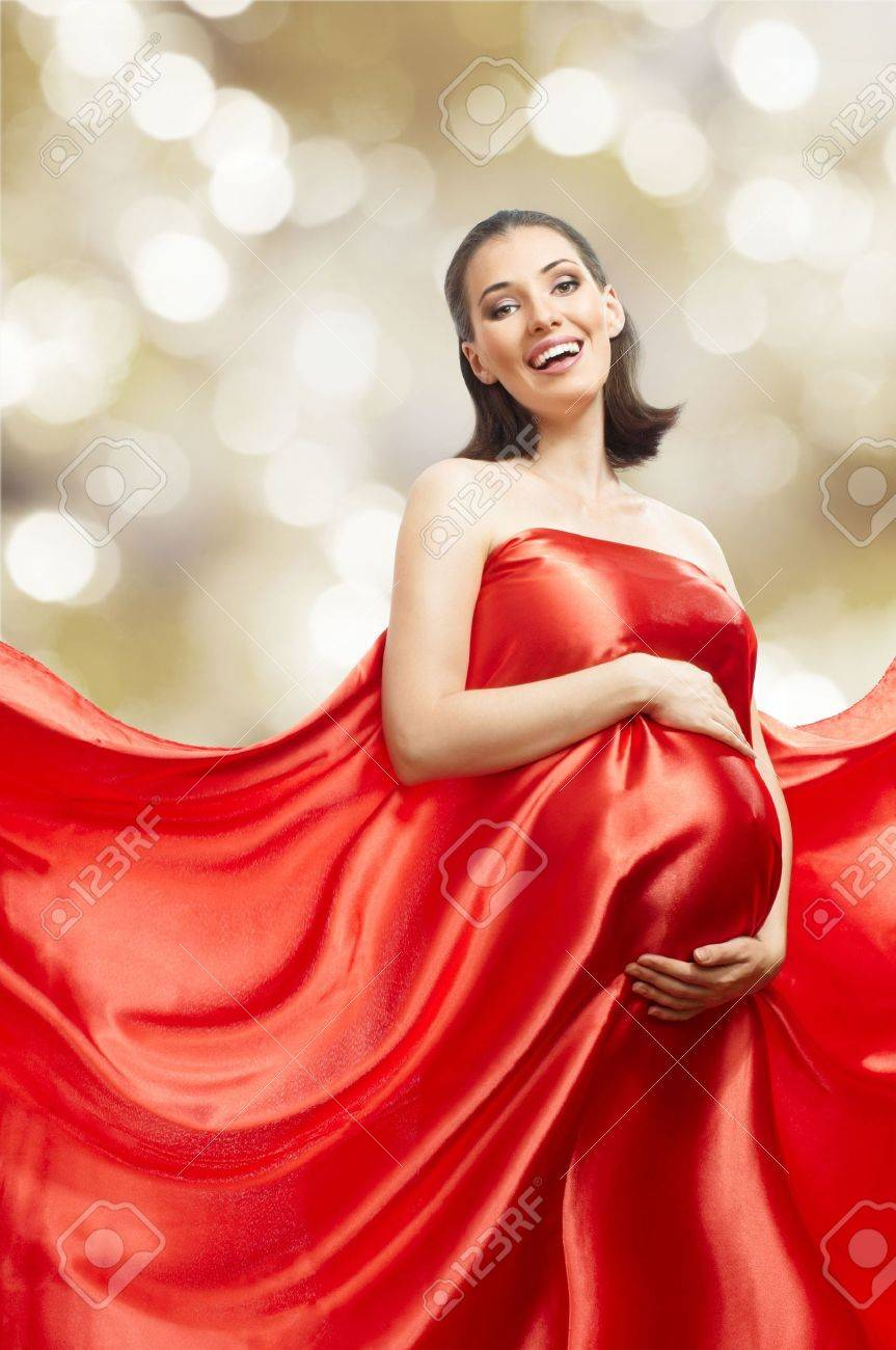 beautiful young woman in red long dress Stock Photo - 8186832
