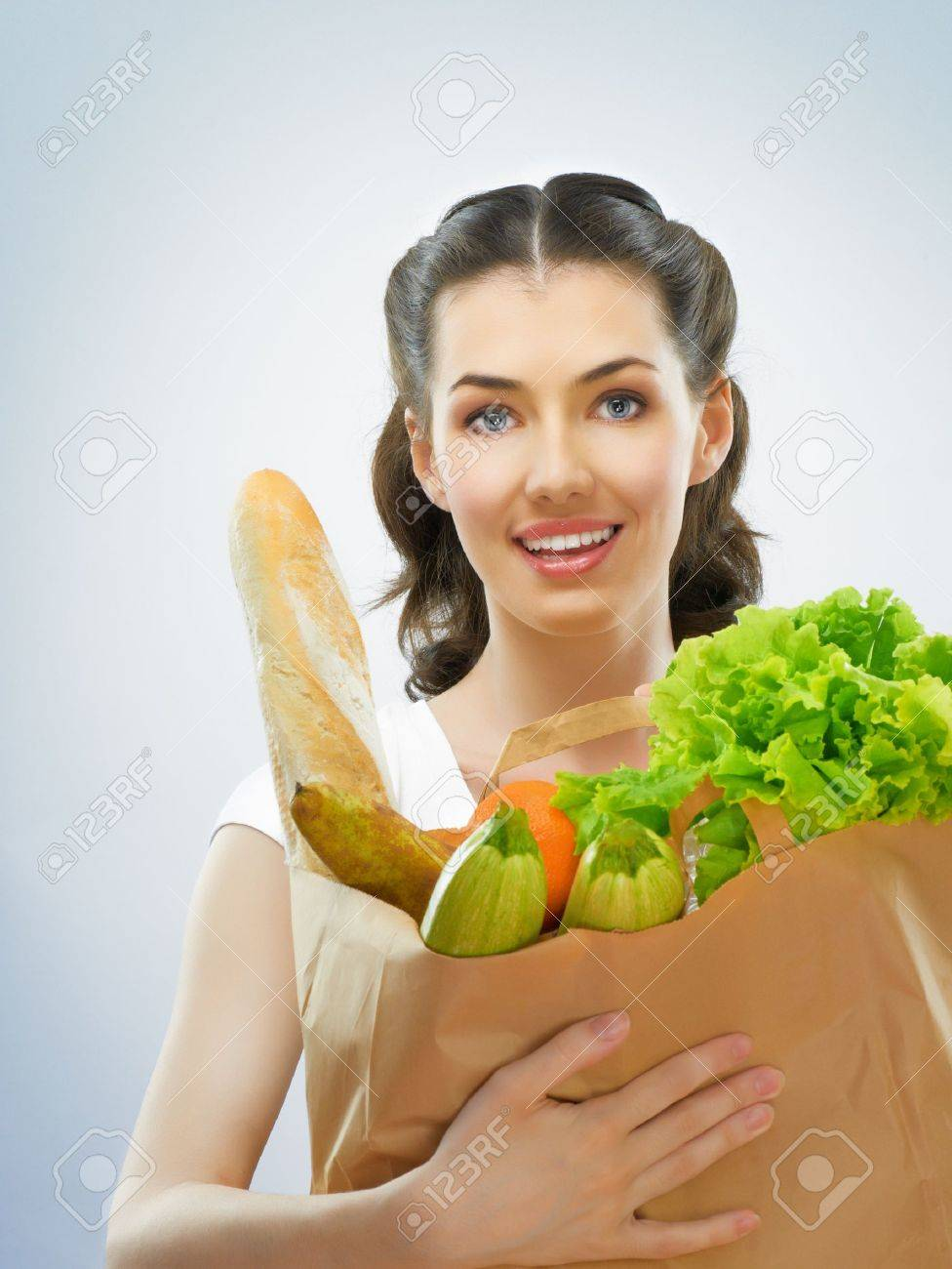girl holding a bag of groceries Stock Photo - 9447180
