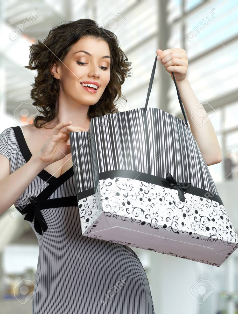 Beautiful woman with shopping bags in hands Stock Photo - 9739955