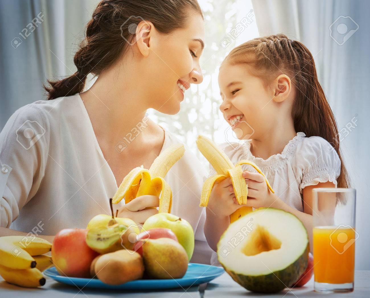 happy family eating fresh fruit - 38558350