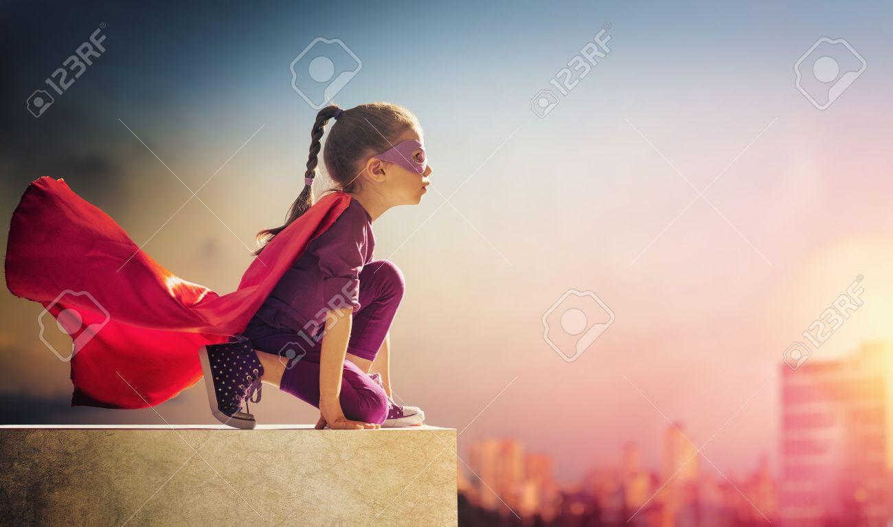 Little child girl plays superhero. Child on the background of sunset sky. Girl power concept - 51914477