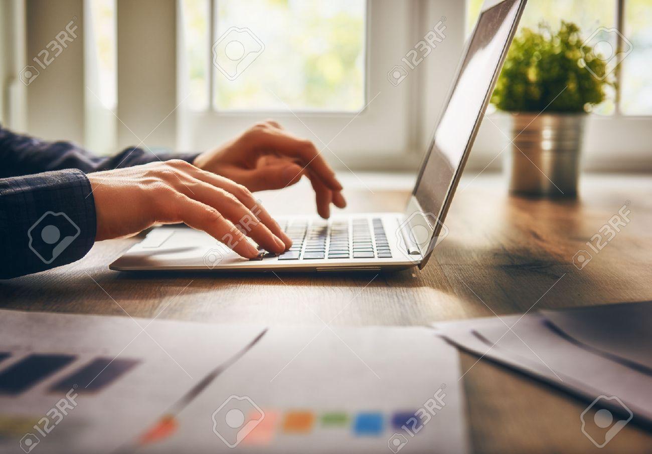 businessman using laptop computer sitting working office. - 51914482