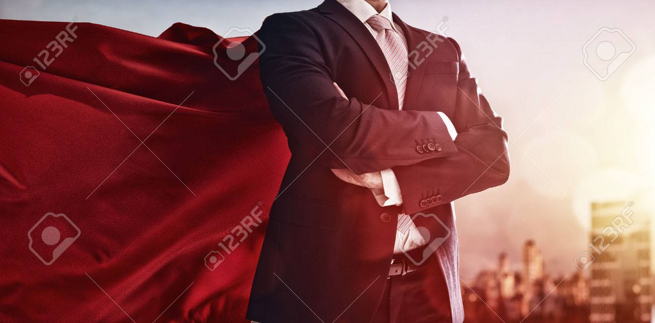 superhero businessman looking at city skyline at sunset. the concept of success, leadership and victory in business. Stock Photo - 51914550