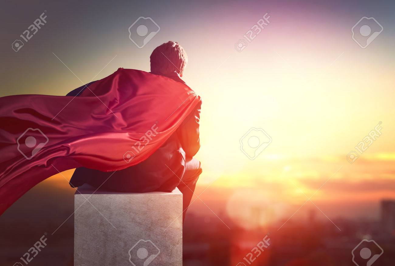 superhero businessman looking at city skyline at sunset. the concept of success, leadership and victory in business. - 51918802