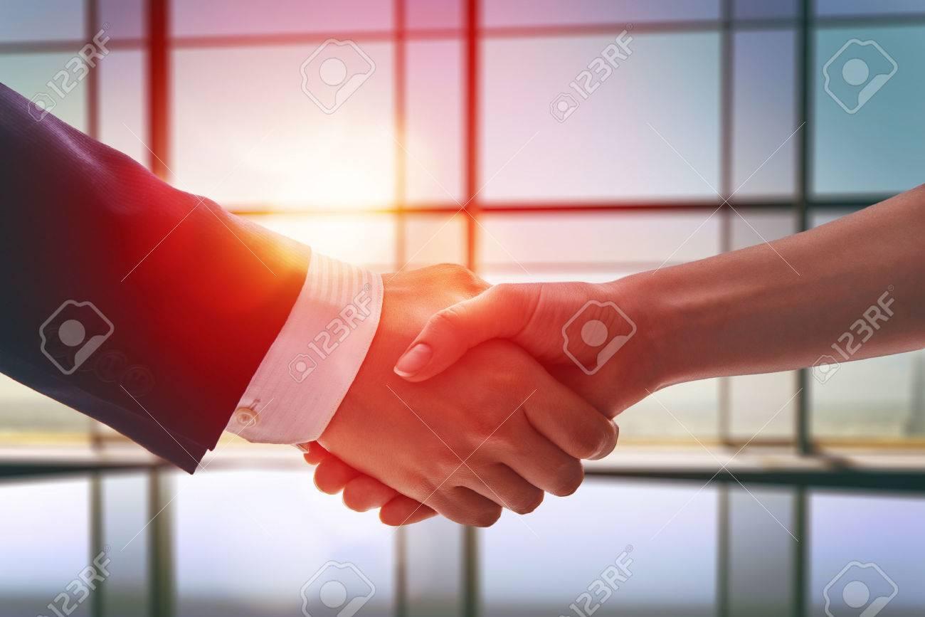 handshake of businessmen. the concept of successful negotiations. - 52328902