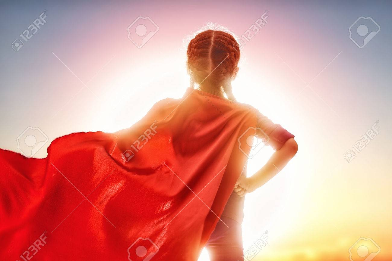 Little child girl plays superhero. Child on the background of sunset sky. Girl power concept - 54018533