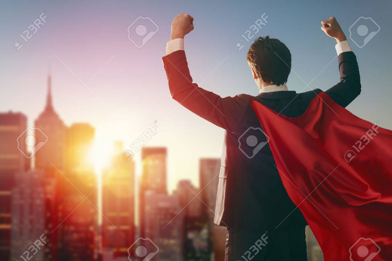 superhero businessman looking at city skyline at sunset. the concept of success, leadership and victory in business. - 54723092