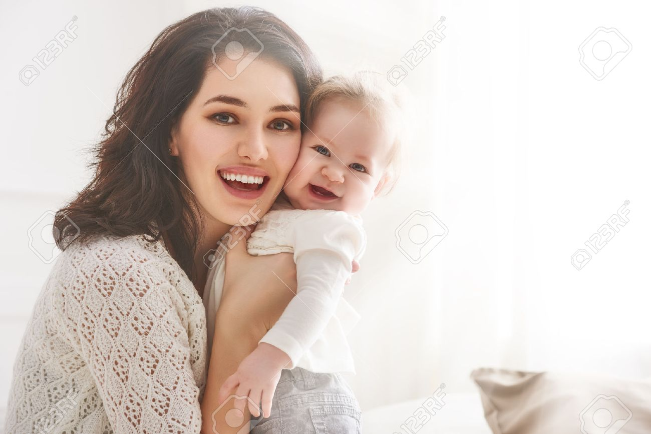 happy loving family. mother playing with her baby in the bedroom. - 54723420