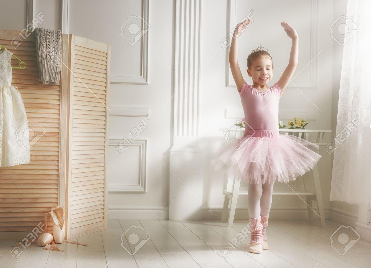 c6176e5b0551 Cute Little Girl Dreams Of Becoming A Ballerina. Child Girl In ...