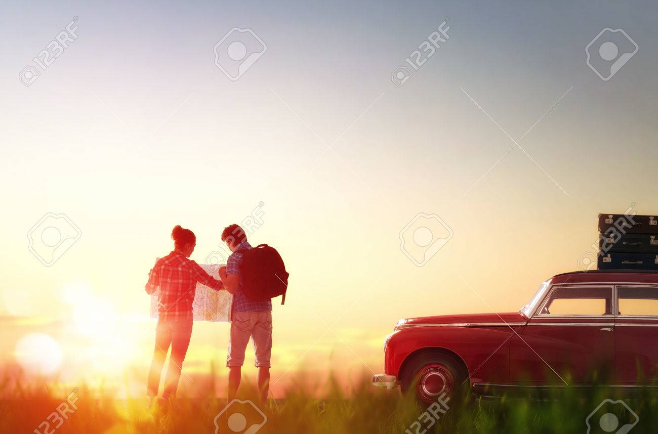 Toward adventure! Man and woman enjoying road trip. Couple searches for a route on the map. - 55146781