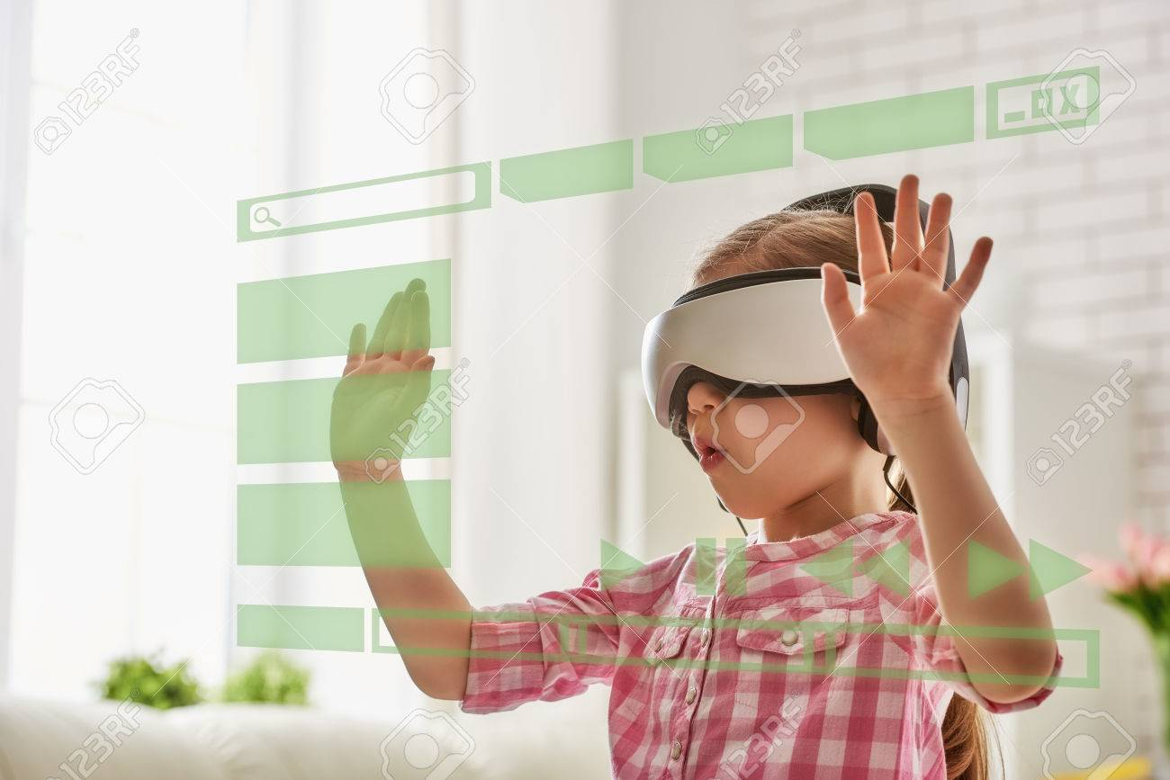 Cute little child girl playing game in virtual reality glasses. - 56412103