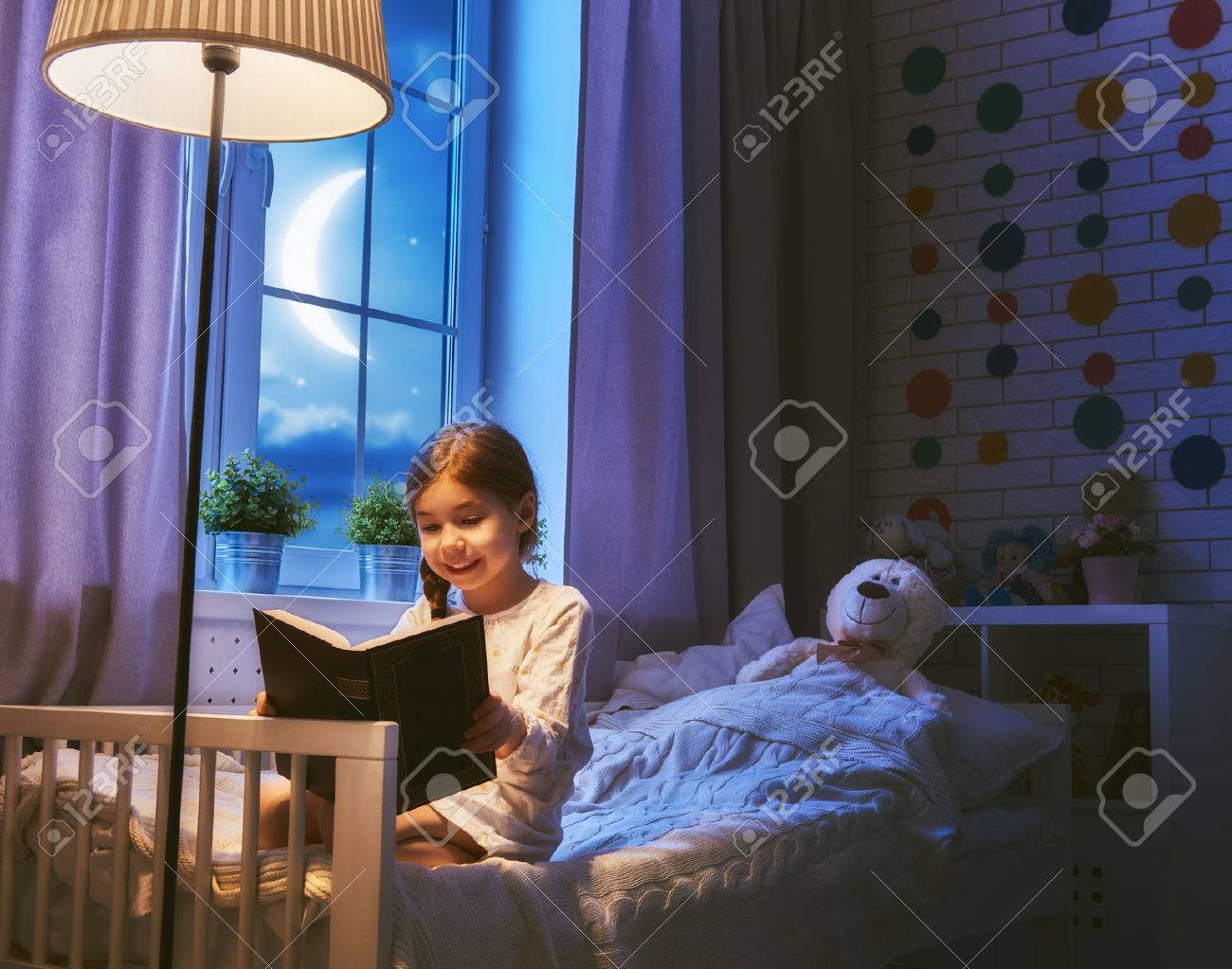 Cute Little Child Girl Reading A Book Under A Lamp. Kid Girl ... for Little Girl With Lamp  110yll